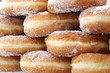 doughnut also called Krapfen with sugar for sale at pastry shop