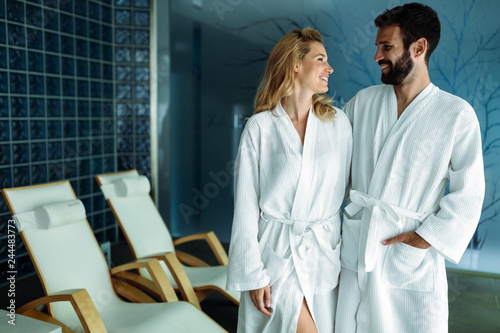 canvas print picture Attractive happy couple relaxing in spa center