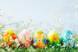Decorative eggs on green grass.