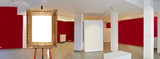 Painter's easel and empty antique golden frame in a exhibition gallery - 244505123