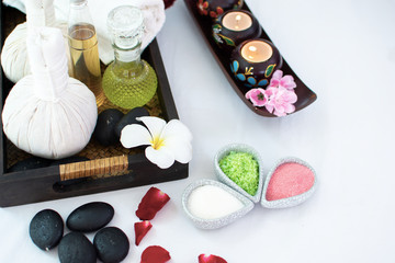 Thai herbal spa elements setting for traditional Thai massage, tropical spa treatment background concept. © seksan94