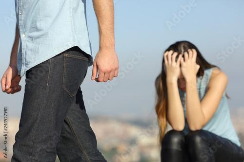 Leinwandbild Motiv Boyfriend leaving his girlfriend after break up