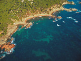 Fototapeta Do pokoju - Drone footage over the Costa Brava coastal near the small town Palamos of Spain © Arpad