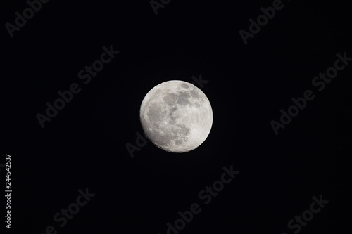 Waning Gibbous Moon on night sky - 244542537
