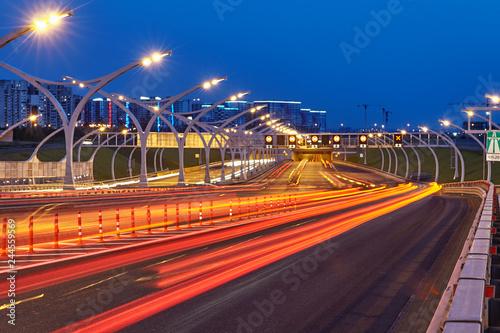 Fridge magnet St. Peterburg's highway illumination in blue hour.