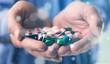Leinwanddruck Bild - Pills in human hands, close-up view