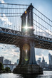 Manhattan Bridge NYC with sun flare through the bridge