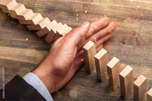 Hand of young business man stopping wooden - 244583907