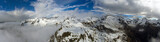 Fototapeta Do pokoju - Aerial landscape with snow mountains © Kokhanchikov
