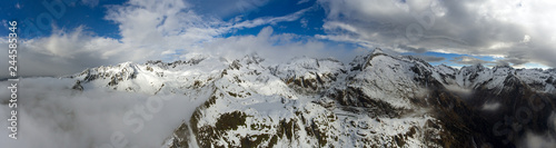 Aerial landscape with snow mountains - 244585346