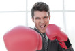 happy businessman in Boxing gloves