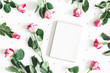 Flowers composition. Pink rose flowers, notebook on white background. Flat lay, top view, copy space