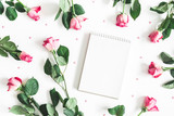 Flowers composition. Pink rose flowers, notebook on white background. Flat lay, top view, copy space - 244597976