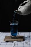 Butterfly Pea Tea. Pour into a glass of blue tea. Welding - 244598779