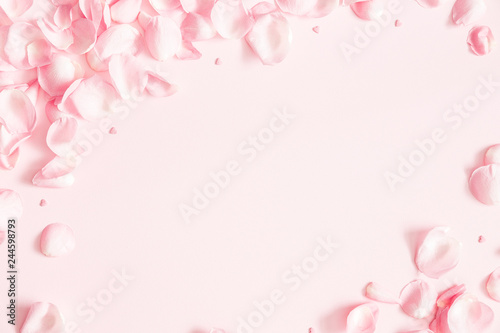 Foto Murales Flowers composition. Rose flower petals on pastel pink background. Valentines day, mothers day, womens day concept. Flat lay, top view, copy space