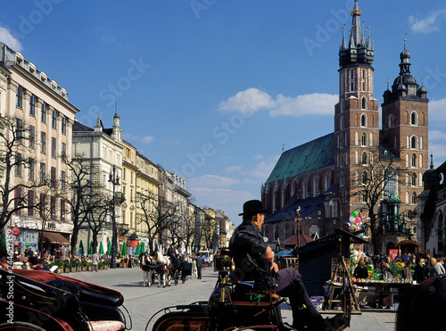 fototapeta na ścianę Krakow, Poland - April, 2010: Main Market Square (Rynek Glowny) and Mariacki Church, of Old Town of Krakow