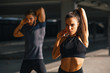 Young sports couple exercising in the urban environment - 244607350