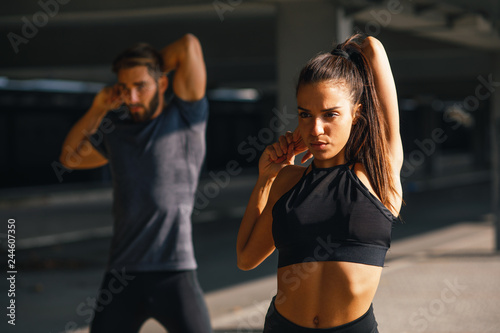 fototapeta na ścianę Young sports couple exercising in the urban environment