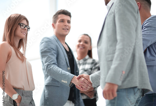 Businessmen shaking hands. Two confident businessmen shaking hands and smiling © FotolEdhar