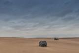 NAMIBE/ANGOLA - 03NOV2018 - All terrain cars in the Namib Desert. Angola. Africa