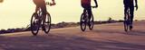 cyclists riding mountain bike on seaside - 244659518