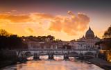 Fototapeta Zachód słońca - Sunset in Rome with the Vatican and the Tiber river. Rome, Lazio, Italy © stefanotermanini