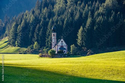 Wonderful Sunny Landscape of Dolomite Alps. St Johann Church, Santa Maddalena, Val Di Funes, Dolomites, Italy. Amazing nature Background