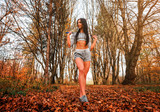 sporty girl with a rope in the park - 244727128