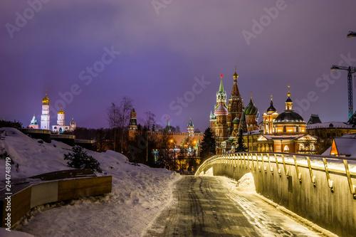 Night view in Zaryadye Park: Moscow Kremlin, St. Basil`s Cathedral and Varvarinskaya Church.
