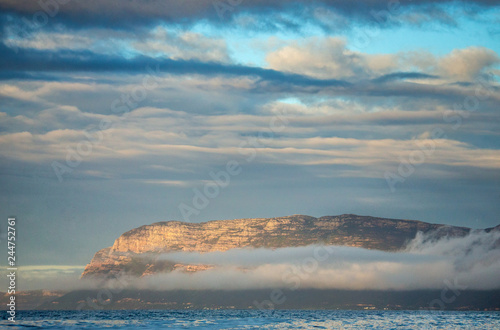Cape of Good Hope from the ocean. Coastline in the fog. Beautiful clouds and dramatic sea. Beautiful seascape. South Africa.