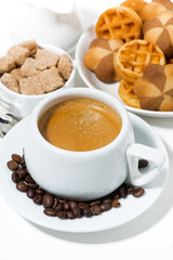 cup of coffee with sweets for dessert, vertical closeup