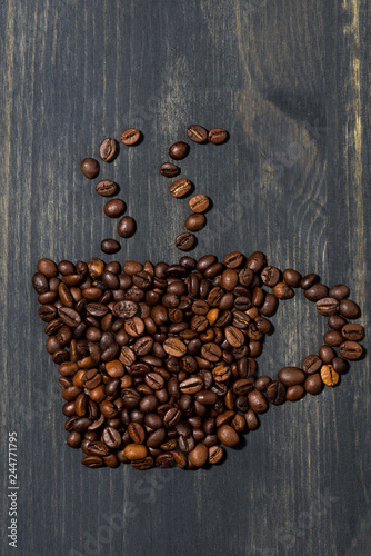 cup of coffee beans, concept photo, vertical