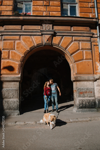 Wall mural love story. stroll. beloved family and dog.  future mom and dad. Pregant woman