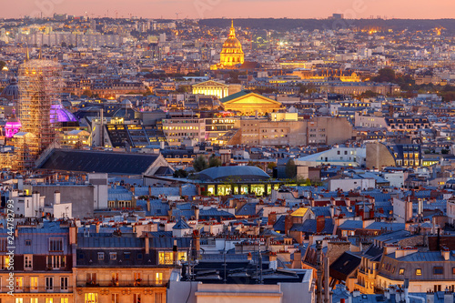 Wall mural Paris. Aerial view of the city at sunset.