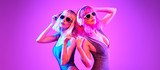 Fashion. Two DJ girl with Dyed Hair in Colorful neon light enjoy music, friends. Party disco 80s 90s vibes. Model woman in fashionable bodysuit, makeup. Creative art banner