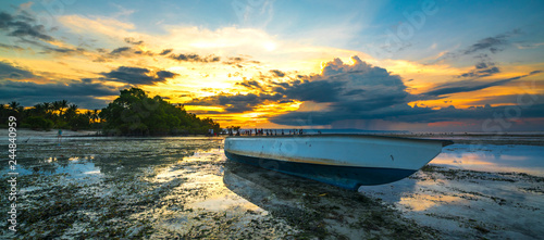 Wooden boat with sunset background - 244840959