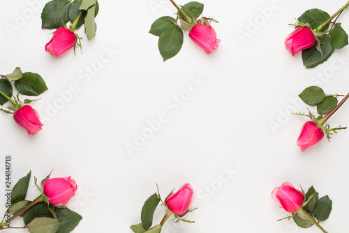 Flowers composition. Frame made of red rose on white background. Flat lay, top view, copy space. - 244841713