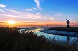 Leuchtturm in Wremen bei Bremerhaven im Sonnenuntergang, Weltnaturerbe Wattenmeer in Norddeutschland