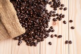 .Coffee beans spilled out from linen sack