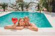 Valentine's day. Happy joyful couple in Pool