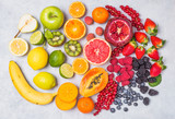 Fototapeta Tęcza - Fruits and berries rainbow top view.Natural vitamins and antioxidants food concept. © travelbook