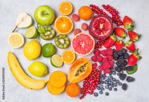 Fruits and berries rainbow top view.Natural vitamins and antioxidants food concept. - 244934368