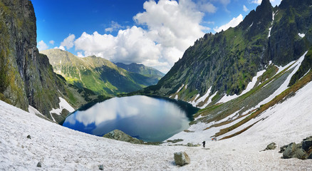 Morskie Oko. High Tatras, Poland, May 27, 2018. Beautiful landscape of snowy mountain tops and the lake between them.