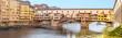 Leinwanddruck Bild - Famous landmark Ponte Vecchio bridge over Arno river in Florence, Italy