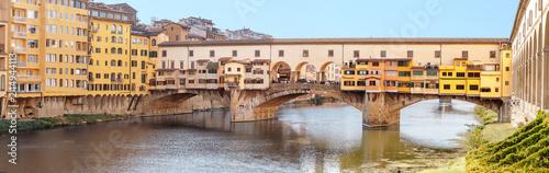 Leinwanddruck Bild Famous landmark Ponte Vecchio bridge over Arno river in Florence, Italy