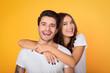 Leinwandbild Motiv Happy casual couple embracing, posing to camera