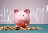 Pink piggy bank and coins on background - 244991994