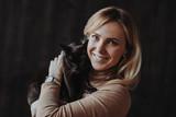 Fototapeta Koty - Woman with cat © Yeko Photo Studio