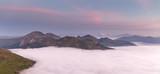 Fototapeta Zachód słońca - Misty Morning in the Alps © sarahgugl