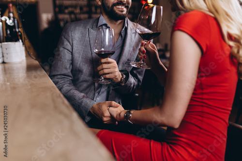 Leinwandbild Motiv Romantic date in restaurant, young couple at bar counter.